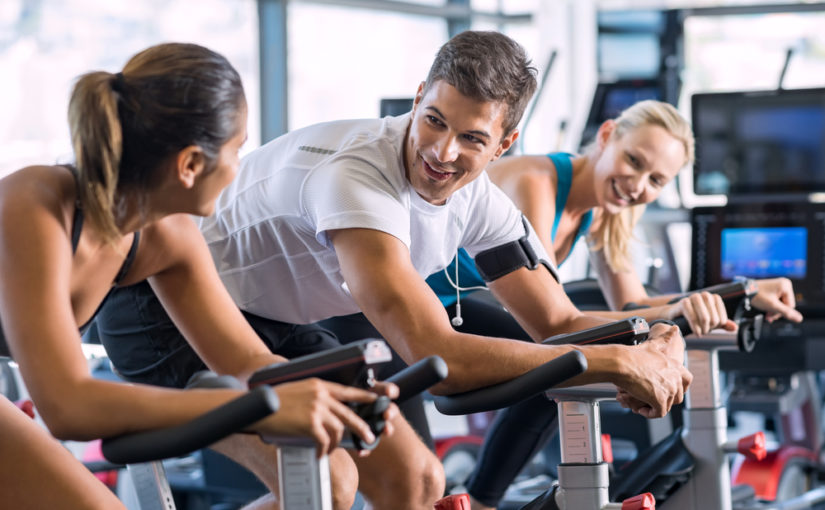 How do an exercise bike and a spinning bike differ?
